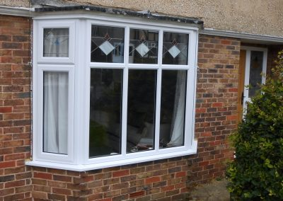 White uPVC Bay Window with Bespoke Coloured Leads